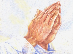 χέρια σε στάση προσευχής